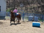Cindy Genette works with Tequila Sunrise on barrel training